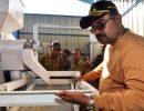 Bupati Karimun, Aunur Rafiq saat meninjau mesin penggilingan padi di Desa Teluk Radang, Kecamatan Kundur Utara